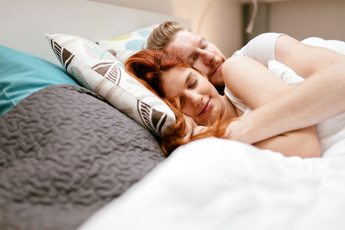Sleep and the immune system - Couple sleeping in bed.