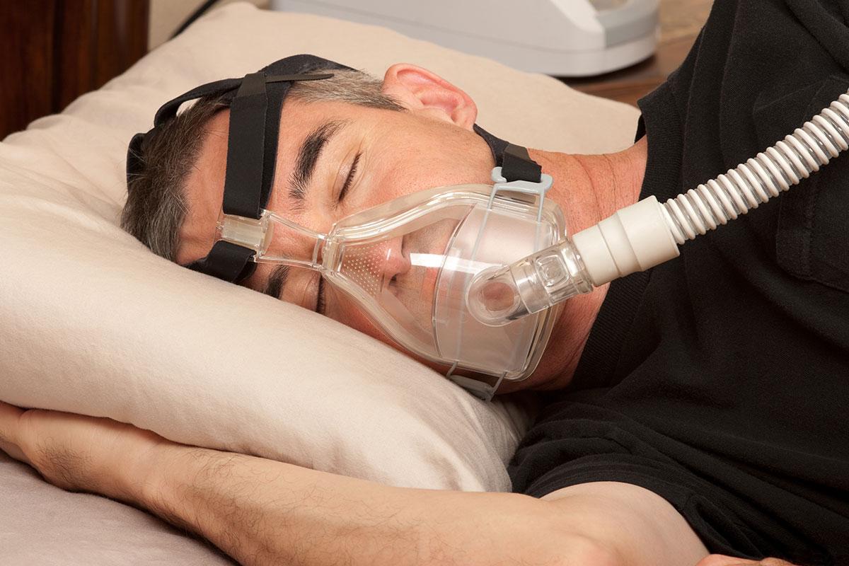 Sleep Apnoea Treatment - Man using a CPAP Machine