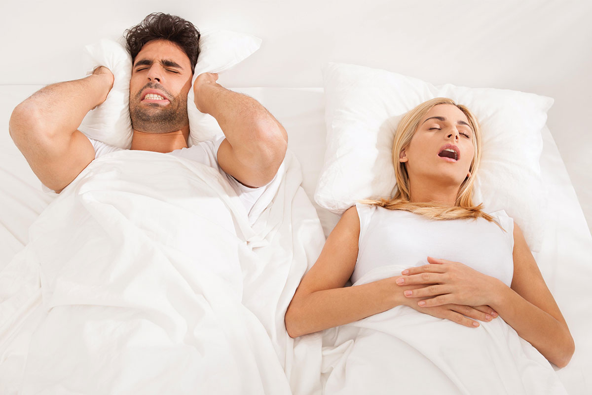 Snoring in Females - Woman snoring in Bed
